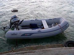 skiff(0.0), watercraft rowing(0.0), motorboat(0.0), dinghy sailing(0.0), dinghy(1.0), vehicle(1.0), boating(1.0), inflatable boat(1.0), watercraft(1.0), boat(1.0),