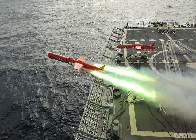USS Thach launches aerial drone for firing exercise.