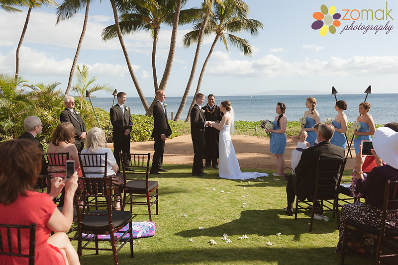 Bride and groom say their vows at the Sugar Beach Events Center at their destination wedding in Maui, Hawaii