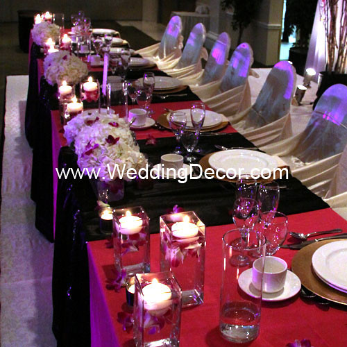 Head table decorations for a wedding reception in black and fuchsia with