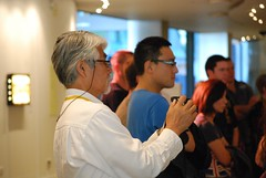 professor goichi videoing mukkuri   ainu cultural exchange