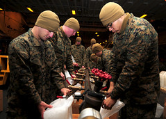 PACIFIC OCEAN (March 25, 2011) Marines assigned to the 31st Marine Expeditionary Unit (31st MEU) fill plastic containers with potable water in the hangar bay of the forward-deployed amphibious assault ship USS Essex (LHD 2). The water will be transported to various locations in Japan as a part of Operation Tomodachi. Essex, USS Harpers Ferry (LSD 49) and USS Germantown (LSD 42) with the embarked 31st MEU are currently operating off the coast of Hachinohe in northeastern Japan. (U.S. Navy photo by Mass Communication Specialist 2nd Class Casey H. Kyhl)
