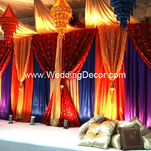 Sangeet mehndi decor a sangeet mehndi backdrop in orange for Sangeet decorations at home