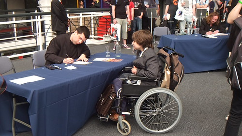 Kid getting his book signing