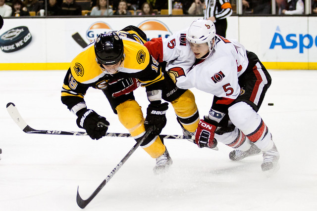 Ottawa Senators #5 Brian Lee collides with Boston's #19 Tyler Seguin on Saturday April 9th at the TD Garden in Boston, Massachusetts. The Bruins won 3-1. (Inside Hockey/Cody Smith)