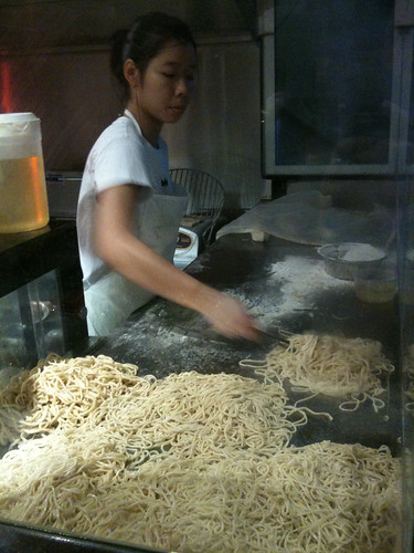 making noodles at the front window