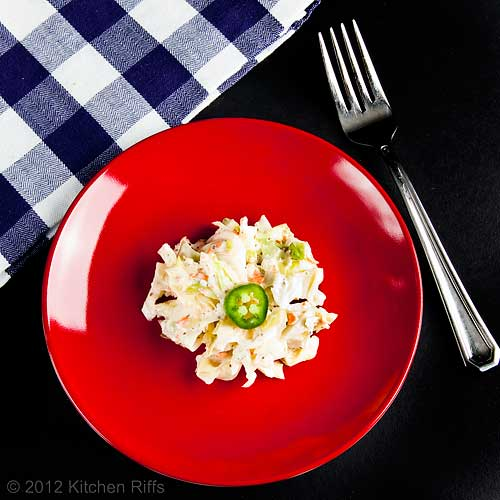 Creamy Coleslaw on Red Plate with Napkin and Fork