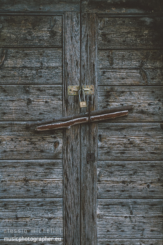 Detail of a door in Palazzo, Arcevia, Italy