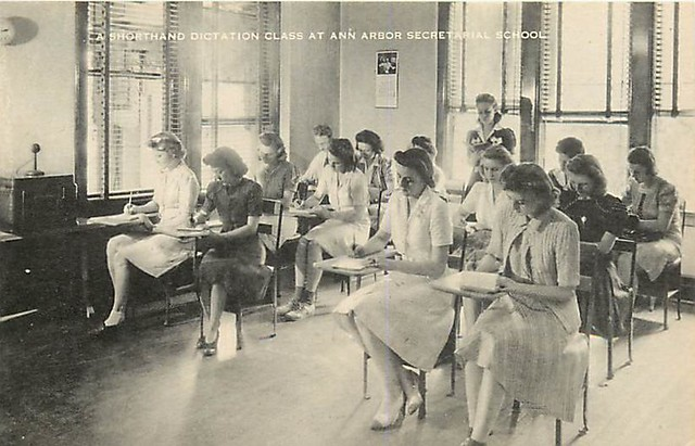 """1940s postcard of the Ann Arbor Secretarial School, upstairs in the Nickels Arcade -- """"A Shorthand Dictation Class."""""""
