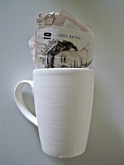 UK pounds in coffee cup