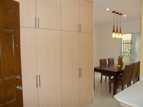 The floor-to-ceiling storage and view of the dining room from the kitchen