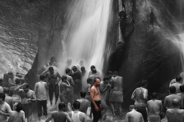 A devotee getting ready to take bath Kutralam
