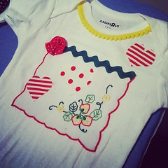 art(1.0), pattern(1.0), baby & toddler clothing(1.0), textile(1.0), clothing(1.0), sleeve(1.0), pink(1.0), t-shirt(1.0),