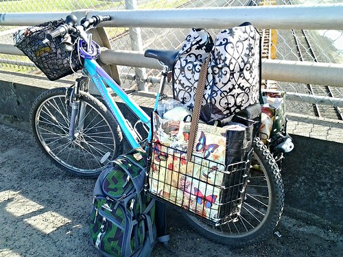 bike with baskets overloaded with groceries