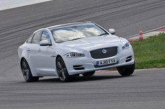 convertible(0.0), automobile(1.0), executive car(1.0), wheel(1.0), vehicle(1.0), performance car(1.0), automotive design(1.0), sports sedan(1.0), full-size car(1.0), jaguar xf(1.0), sedan(1.0), personal luxury car(1.0), land vehicle(1.0), luxury vehicle(1.0),