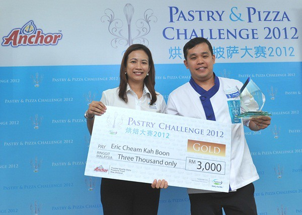 Fonterra FS Pic5 Victorious Cheam receiving the Gold Award for the Pastry Challenge.