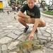 justin touching the iguana