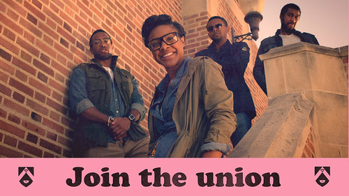 a group of black students standing on the steps of a college campus. Text reads Join the Union