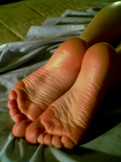 small wrinkled soles on bed
