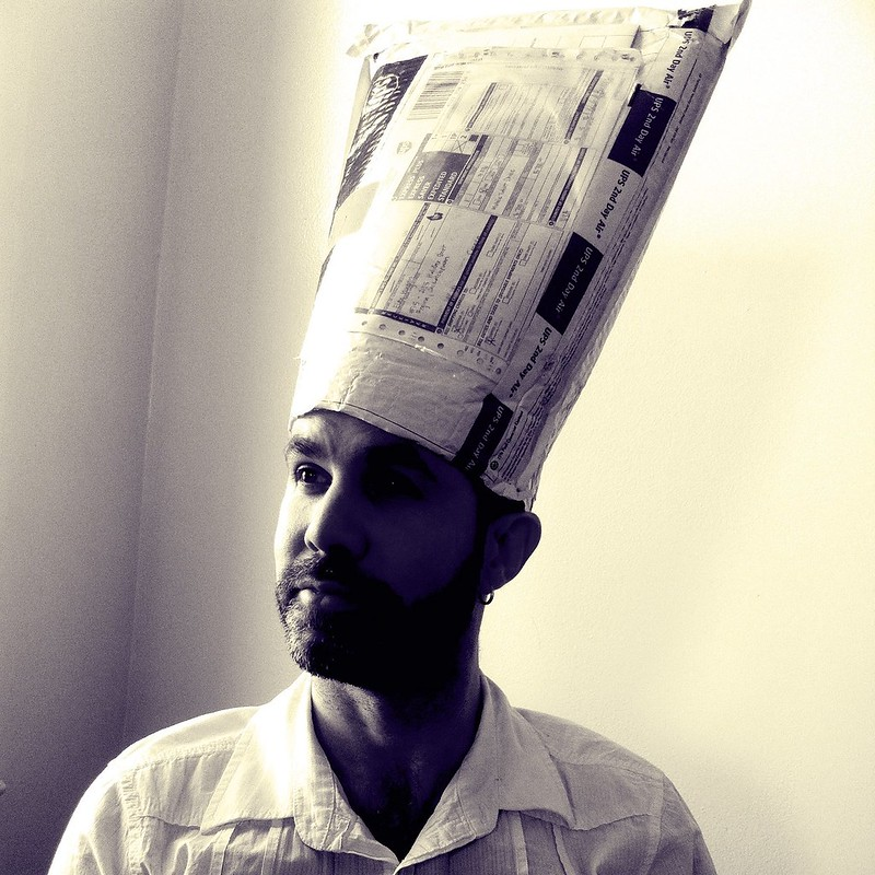 the man in the envelope hat