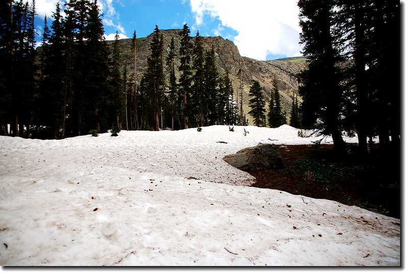 The trail to the lake was still covered in snow