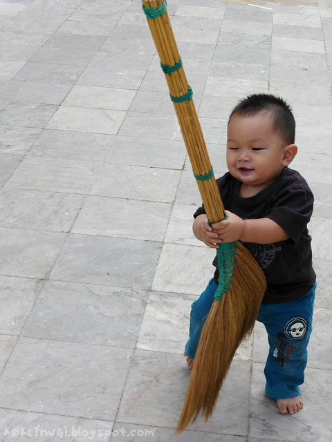 Luang Prabang 03 Haw Pha Bang Toddler with Broom