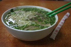 Lanzhou Lamian Pulled noodles with beef, coriander and soup with chopsticks by Engineer J