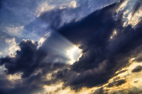 Punch Hole in the Clouds with Crepuscular Rays