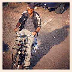 Young guy cycling in Amsterdam