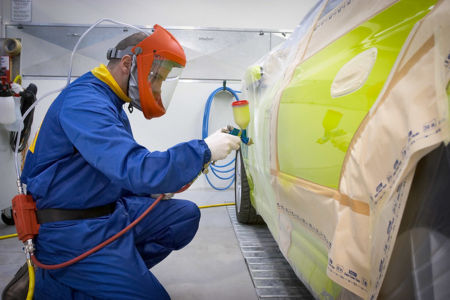 Guy spray painting a car flickr photo sharing for Air compressor for auto painting