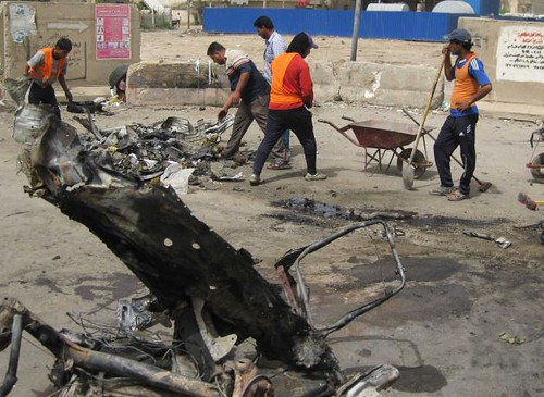 Wreckage from Baghdad explosions that took place on April 19, 2012. Despite the withdrawal of US combat troops the violence continues inside the country. by Pan-African News Wire File Photos
