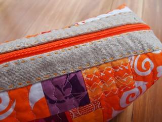 Hand stitching on linen /Zipper.