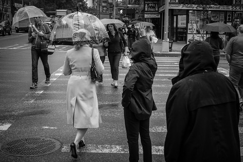 A little bit of rain didn't bother the X-Pro1, but did offer some nice scenes to photograph. When shooting on the streets in large cities, I find crosswalks and street corners offer plenty of opportunities. 1/125, f5.6 at ISO 640.