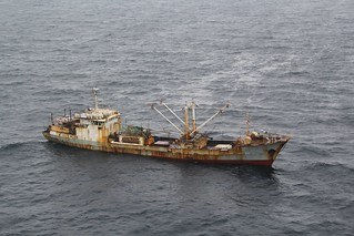 The fishing vessel Yin Yuan is transferred from the custody of the crew of the Coast Guard Cutter Morgenthau to China coast guard vessel 2102 in the North Pacific Ocean June 3, 2014. The Yin Yuan crew is suspected of three serious fisheries violations including: use of prohibited fishing gear of more than 3.3 kilometers of high seas drift net, failure to maintain sufficient records of catch and catch-related data, and fishing without a license, permit or authorization issued by a sanctioned authority. U.S. Coast Guard photo by Coast Guard Cutter Morgenthau.
