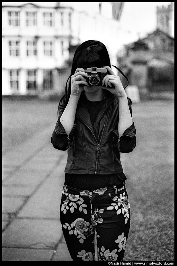 Photographer using a Diana F Lomo camera