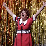 """A 30-year-old Annie (Valerie Fagan) regrets her career choice in """"Forbidden Broadway,"""" presented by the Huntington Theatre Company through at the Calderwood Pavilion at the Boston Center for the Arts. Part of the 2005-2006 season. Photo by Eric Antoniou."""
