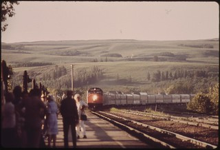 People on the loading platform at East Glacier Park Montana, watch the arrival of the Empire Builder (Train #7) from Chicago enroute to Seattle, Washington, June 1974
