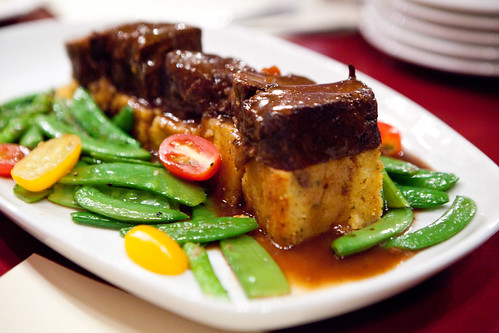 Chile braised short ribs with sweet corn pudding