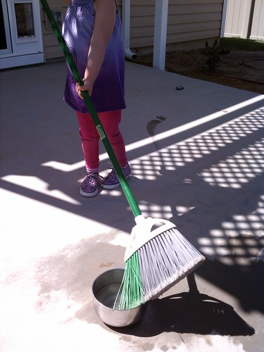 Painting with water and a broom