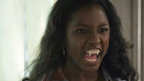 Tara as a vampire, showing her teeth