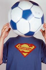 football player(0.0), player(0.0), ball(1.0), clothing(1.0), blue(1.0), ball(1.0), football(1.0),