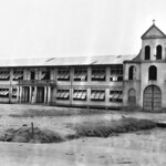 Divine Word University Church, Tacloban, Leyte, Philippines, 1945.  On the building under the cross is 1938.