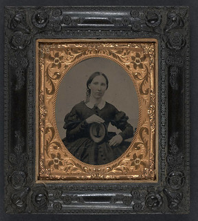 [Unidentified woman wearing mourning brooch and displaying framed image of unidentifed soldier] (LOC)