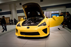 automobile, automotive exterior, exhibition, yellow, vehicle, lexus lfa, performance car, automotive design, lexus, auto show, land vehicle, supercar, sports car,