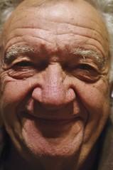 grandparent(0.0), elder(0.0), nose(1.0), face(1.0), skin(1.0), man(1.0), senior citizen(1.0), head(1.0), close-up(1.0), wrinkle(1.0), person(1.0), portrait(1.0), smile(1.0), eye(1.0),