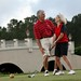 A couple enjoys golf at Hampton Hall