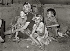 White mother with children at migrant camp, Weslaco, TX, by Russell Lee 1939