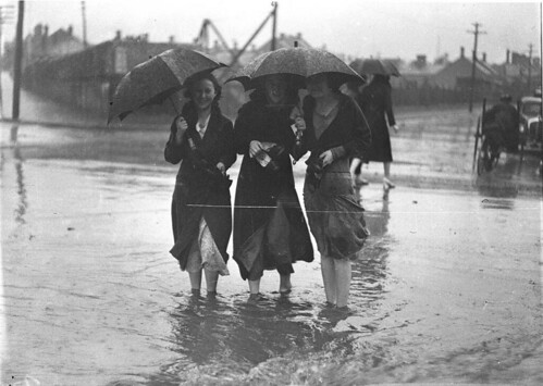 People crossing a flooded street at Alexandria, Sydney, 6 September 1934, by Sam Hood