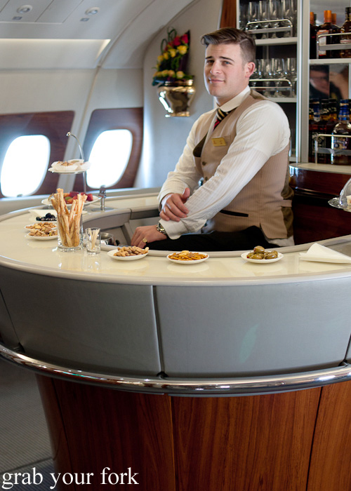 Horseshoe bar in the Emirates A380 Business Class onboard lounge