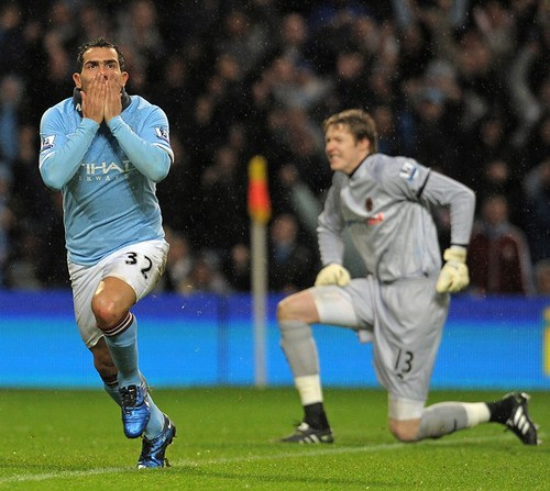 Carlos Tevez happy